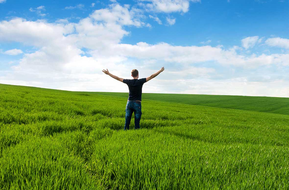 Man Standing in a Field